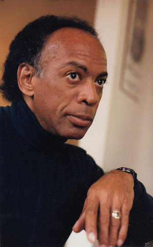 Photo of Wallace Warfield, a Black man, in a black turtleneck.