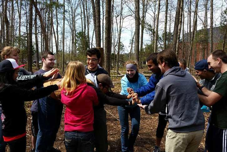students are outdoors gaining experience in team building
